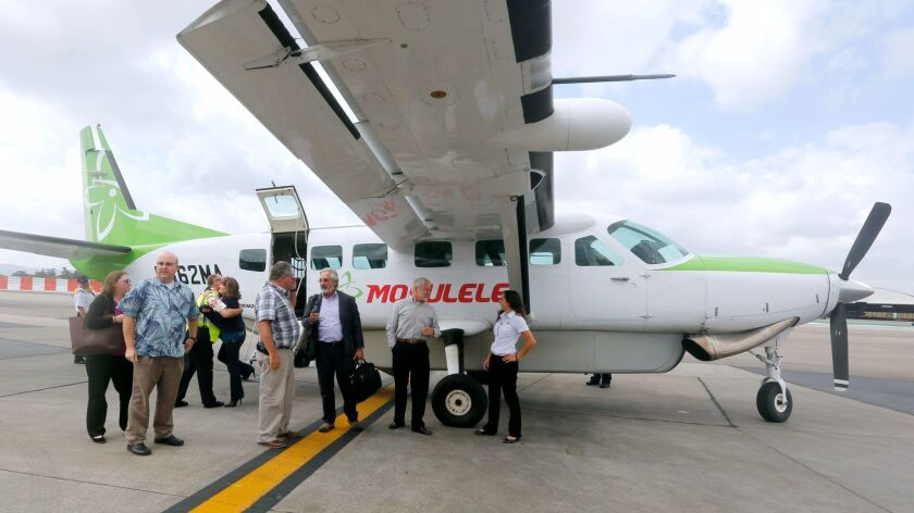 Passengers are greeted as they get off the inaugural Mokulele Airlines flight from Santa Maria to th