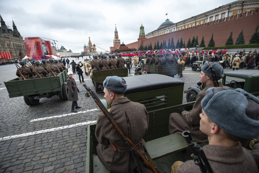 Russian soldiers dressed in Red Army World War II winter uniforms wait to take a part in a reconstruction of a World War II-era parade in Moscow's Red Square, Russia, Thursday, Nov. 7, 2019. The parade marks the 78th anniversary of a World War II historic parade in Red Square and honored the participants in the Nov. 7, 1941 parade who headed directly to the front lines to defend Moscow from the Nazi forces. (AP Photo/Alexander Zemlianichenko)