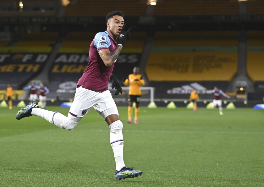 West Ham's Jesse Lingard celebrates after scoring his side's opening goal during the English Premier League soccer match between Wolverhampton Wanderers and West Ham United at Molineux Stadium in Wolverhampton, England, Monday, Apr. 5, 2021. (Laurence Griffiths/ Pool via AP)