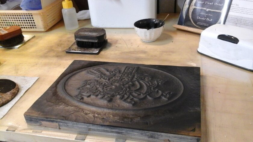 In this Dec. 10, 2015 photo, a woodblock lies on a table in the Mokuhankan print studio, in Asakusa, Tokyo. Mokuhankan offers tourists a hands-on experience making a simple Japanese woodblock print using traditional methods. (Linda Lombardi via AP)