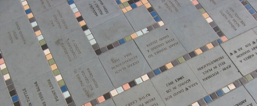 The Ocean Beach Tile Project features ceramic tiles displaying personalized messages installed along Newport Avenue.