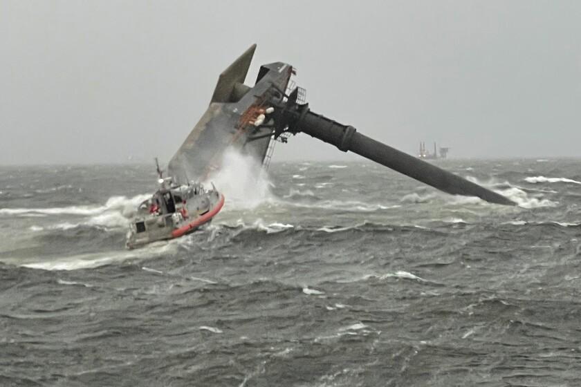 Coast Guard boat by capsized vessel