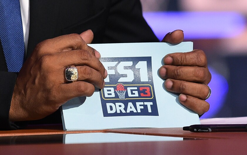 BIG3 league co-founder Ice Cube holds cue cards during the BIG3 2018 Draft at Fox Sports Studio in April 2018.