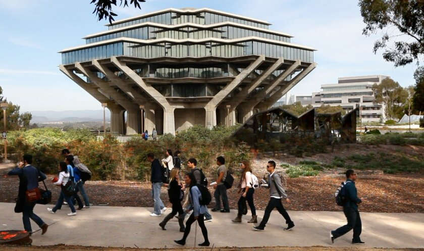 UCSD students walk by the Geisel Library in the heart of campus in this 2011 photo.
