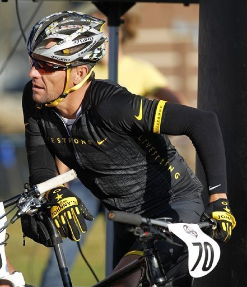 FILE - In this Aug. 25, 2012, file photo, cyclist Lance Armstrong prepares to take part in the Power of Four mountain bicycle race in Snowmass Village, Colo. With U.S. anti-doping officials set to issue their report on Armstrong's case, a lawyer for the cyclist on Tuesday again criticized the process which led to himn being banned from the sport for life. (AP Photo/David Zalubowski, File)