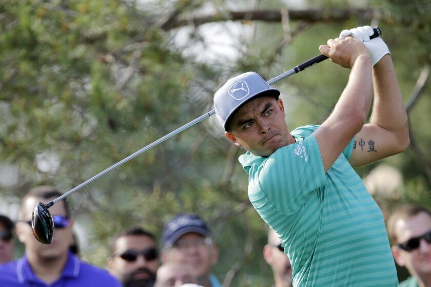 Rickie Fowler watches his tee shot on the 11th hole during the first round of the Memorial golf tournament, Thursday, June 2, 2016, in Dublin, Ohio. (AP Photo/Darron Cummings)
