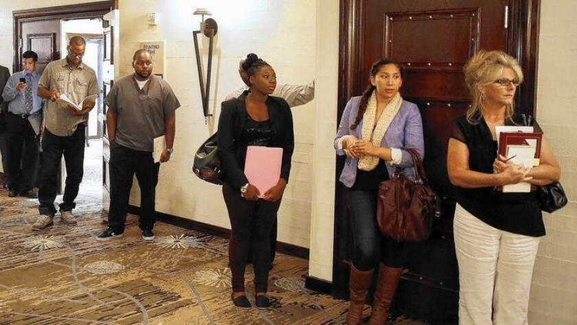 Job-seekers at a career fair in Ontario, Calif. California's unemployment rate held steady at 7.3% in October.