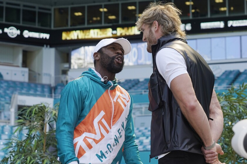 Boxers Floyd Mayweather and Logan Paul taunt each other during a news conference Thursday, May 6, 2021, in Miami Gardens, Fla. Mayweather and Paul are scheduled to face off in an exhibition bout June 6. (AP Photo/Marta Lavandier)