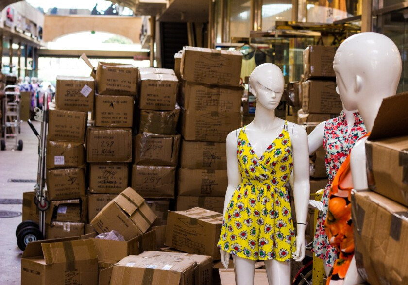 Mannequins and boxes packed with garments in the L.A. Fashion District.