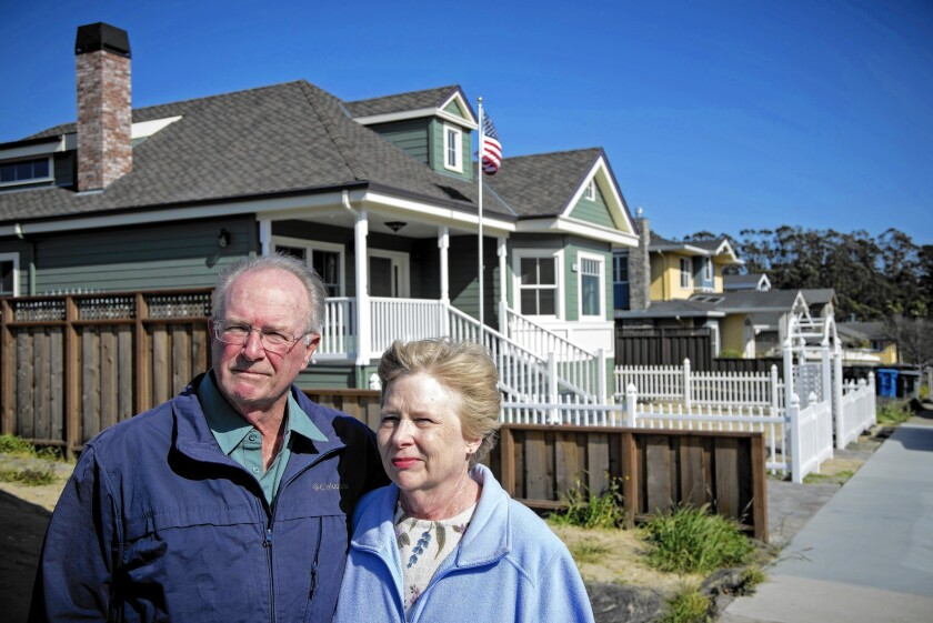 """The 2010 natural gas explosion in San Bruno, Calif., caused the floor in the home of John McGlothlin and wife Joanne to tremble like an """"earthquake,"""" he says. Above, the couple visit an empty lot last week where a house was destroyed by the blast."""
