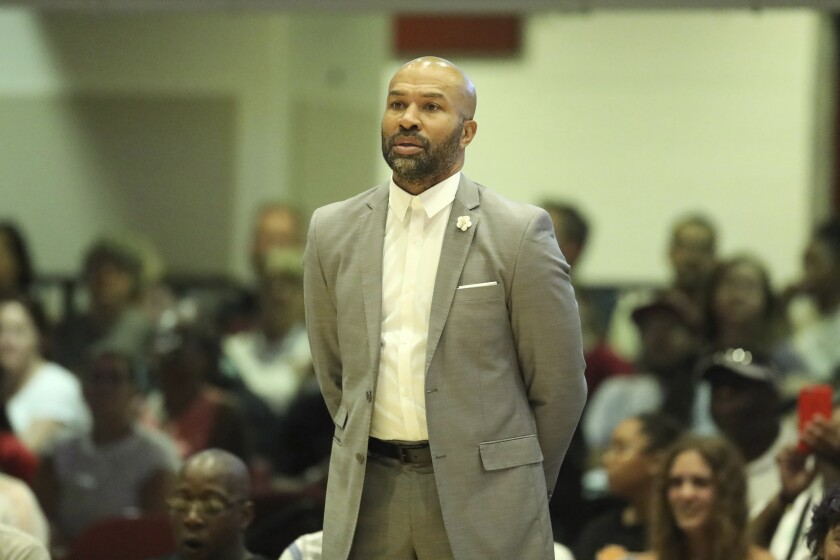 Sparks head coach Derek Fisher is seen on the sidelines against the New York Liberty during a game on July 20 in White Plains, N.Y.