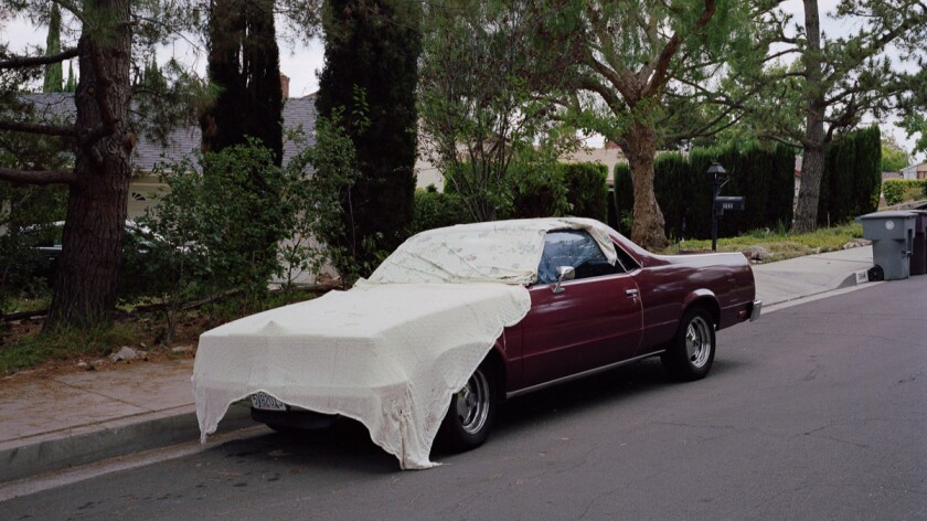 "An image from the series ""Under Cover Cars,"" by Clint Woodside."