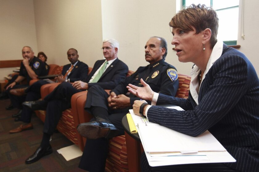 U.S. Attorney Laura Duffy speaks as she, Chula Vista Police Chief David Bejarano, second from right, San Diego Sheriff Bill Gore, and other law enforcement officials hold a forum