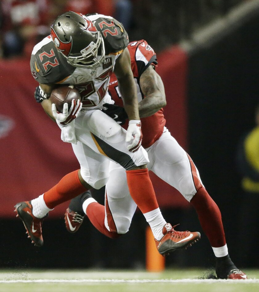 Tampa Bay Buccaneers running back Doug Martin (22) runs against Atlanta Falcons free safety Ricardo Allen (37) during the second of an NFL football game, Sunday, Nov. 1, 2015, in Atlanta. (AP Photo/David Goldman)