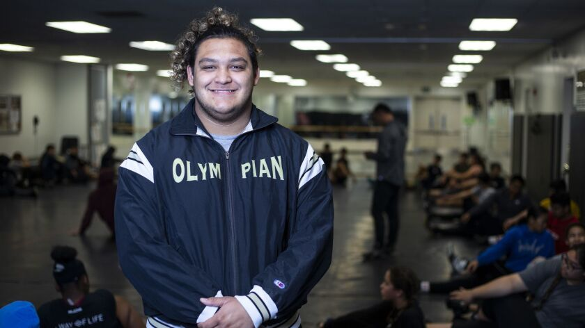 Olympian High wrestler Luis Castro, who is the team captain, has his eyes set on a state title.