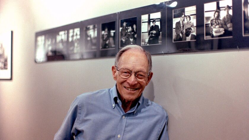 The late Arthur Lavine of Rancho Bernardo with some of his photos at an exhibit at the PhotoGraphic Gallery in New York City in 2006.