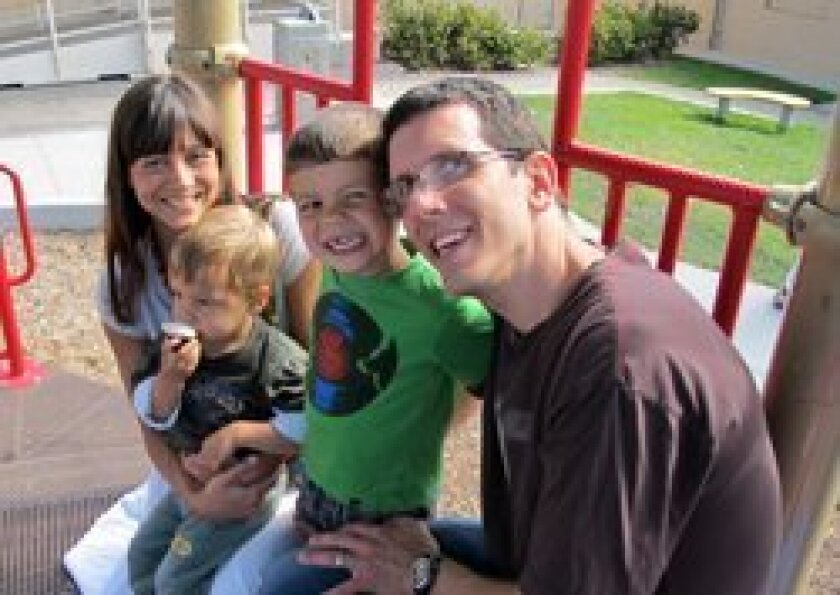 Luciana Powell with her husband, Michael, and sons Nicolas and Alexander.