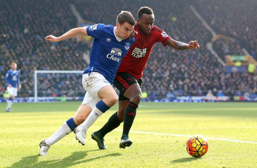 West Bromwich Albion's Saido Berahino and Everton's Seamus Coleman, left, battle for the ball during the English Premier League soccer match at Goodison Park, Liverpool, England, Saturday Feb. 13, 2016. (Martin Rickett/PA via AP) UNITED KINGDOM OUT