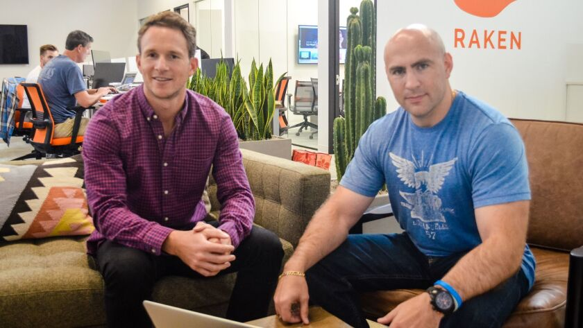 Raken cofounders Kyle Slager, left, and Sergey Sundukovskiy at their company office at the Make pro