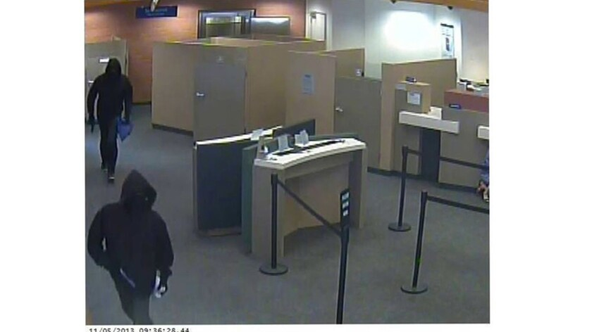 Two masked men dubbed the Cowboy Gun Bandits and later identified as Dominic Dorsey and Reginald Bailey are seen robbing the Citibank branch at 414 N. Central Ave. in Glendale on Nov. 5, 2013.