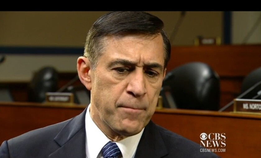 Rep. Darrell Issa (R-Vista) prepares to sling a fastball past Sharyl Attkisson of CBS News.
