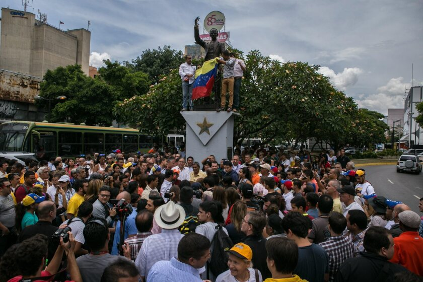 Backers of Venezuelan opposition leader Leopoldo Lopez gather at the Jose Marti de Chacao square in Caracas on Friday.