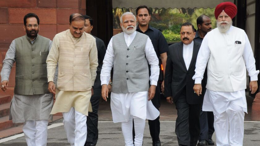 Prime Minister Narendra Modi, center, arrives to speak to the media at the resumption of the Indian Parliament's budget session in New Delhi on March 9, 2017. (European Pressphoto Agency)