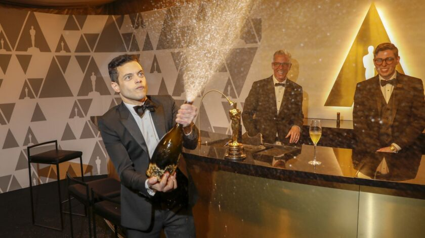 Rami Malek, winner of the lead actor Oscar, pops Champagne at the Governors Ball following the 91st Academy Awards.