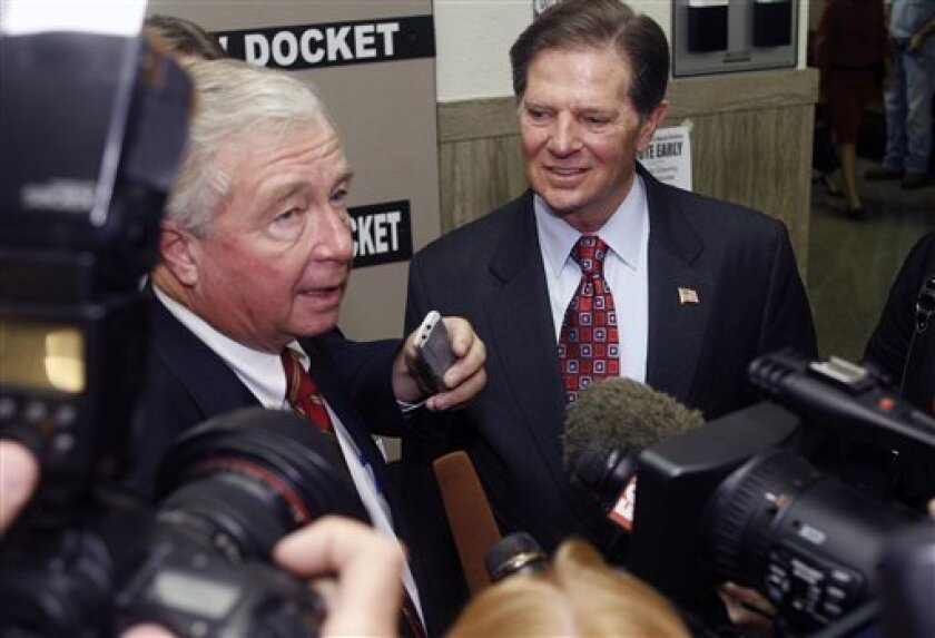 FILE - In this Oct. 26, 2010, file photo, Tom DeLay, right, answers questions from members of the media with his attorney, Dick DeGuerin, left, at the Travis County courthouse in Austin, Texas. Opening statements began Monday, Nov. 1, 2010, in the trial of the former U.S. House Majority Leader, who is accused of helping to illegally finance Texas legislative races in 2002. (AP Photo/Jack Plunkett, File)