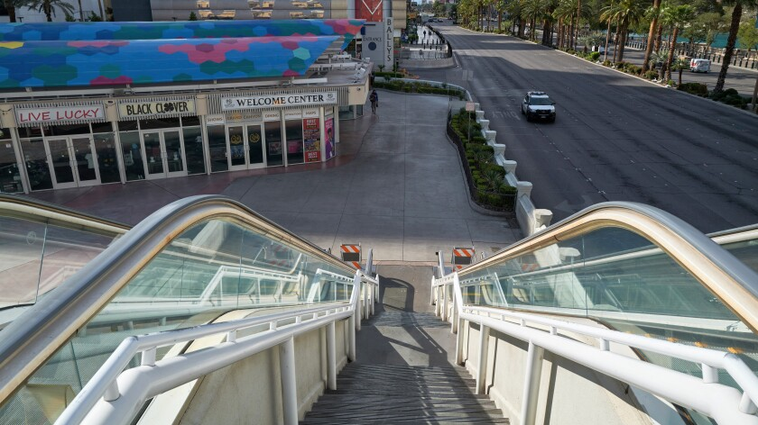 An escalator leading to the Grand Bazaar Shops and Bally's in Las Vegas has gone quiet.