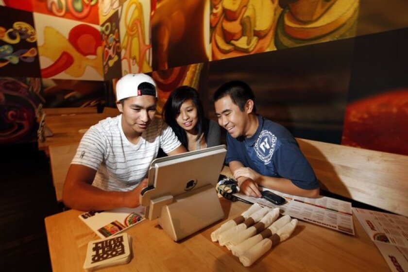 Diners navigate the iPad ordering system at Stacked in Torrance.