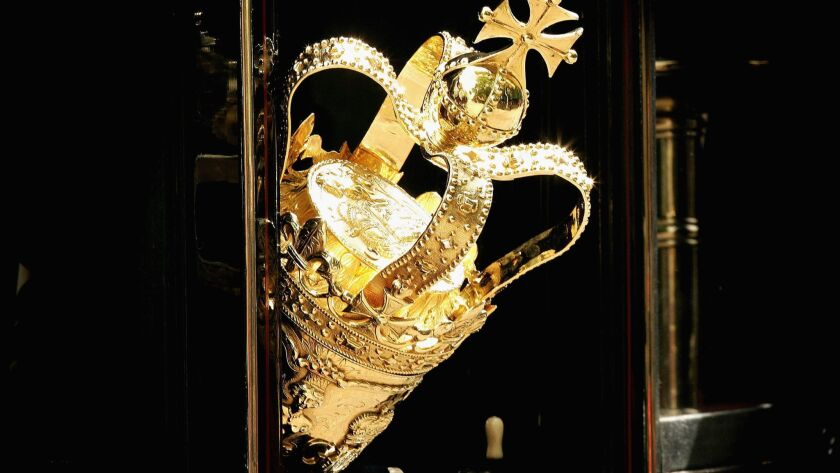 The ceremonial mace is seen protuding from a carraige window as it travels to The House of Lords for the state opening of Parliament.