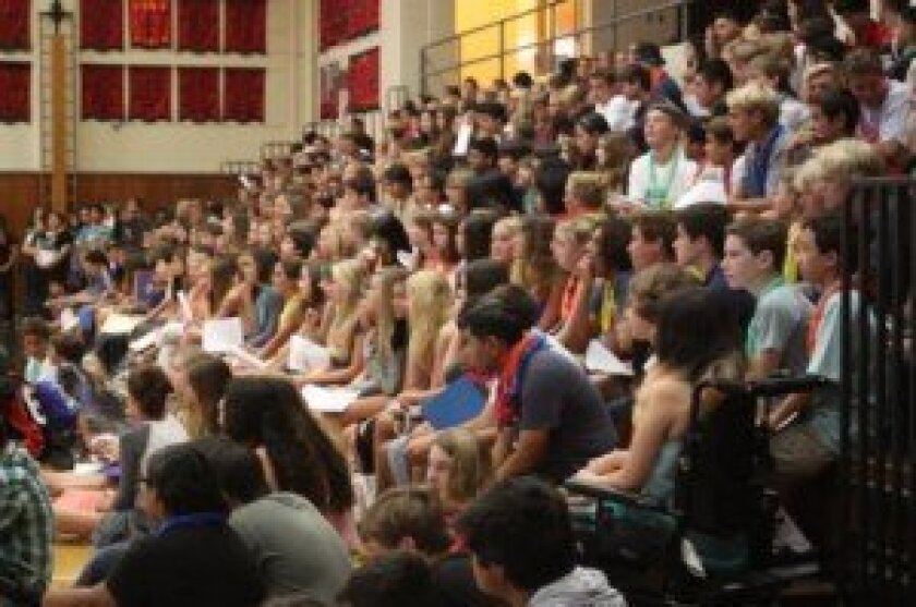 Before breaking into smaller groups, the class of 2018 gathers in the gym.