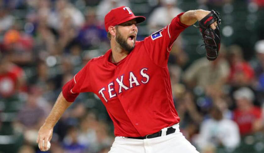 Rangers pitcher Chris Martin delivers during a game against the Angels in September 2018.
