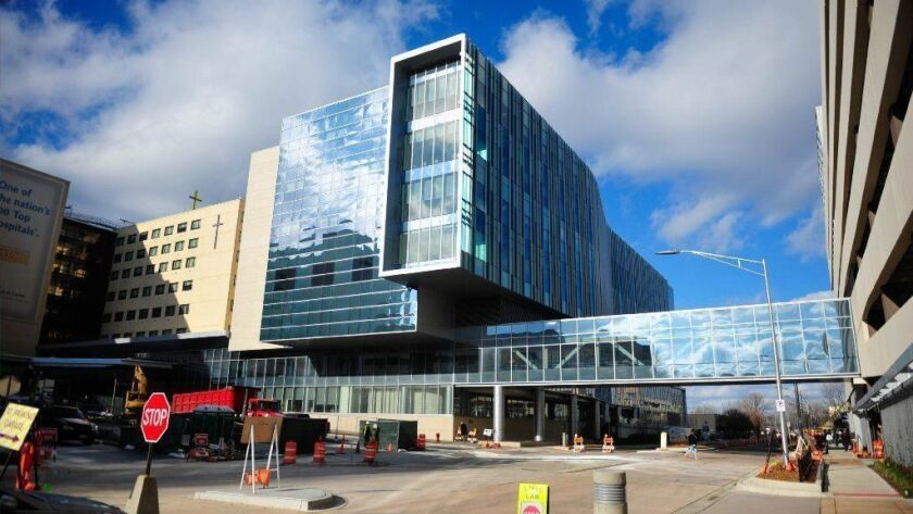 Advocate Christ Medical Center's east tower is seen in 2015 in Oak Lawn. Patients who come in to the hospital's emergency room with opioid overdoses or addictions now will be sent home with naloxone, an antidote for overdoses.