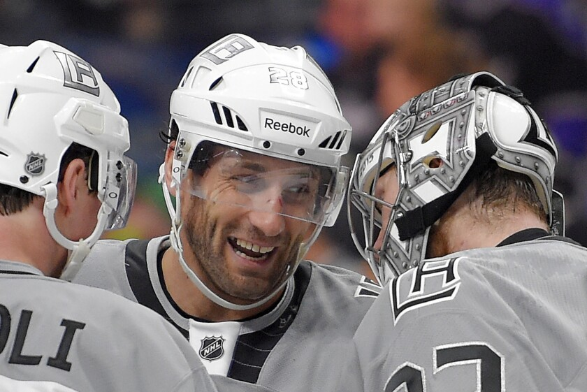 Kings forward Jarret Stoll, center, congratulates goalie Jonathan Quick, right, after a game against the San Jose Sharks on April 11.