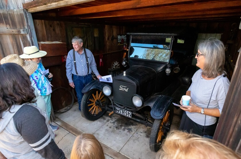 Bumann ranch owner Richard Bumann shows off this 1923 Model T to participants of an Encinitas history tour that visited the property as one of their many stops throughout the city recently.