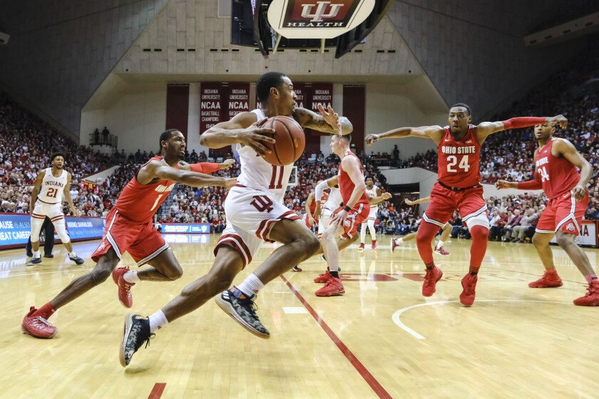 Indiana guard Devonte Green (11) drives in front of Ohio State guard Luther Muhammad (1) during the first half of an NCAA college basketball game in Bloomington, Ind., Saturday, Jan. 11, 2020. (AP Photo/AJ Mast)