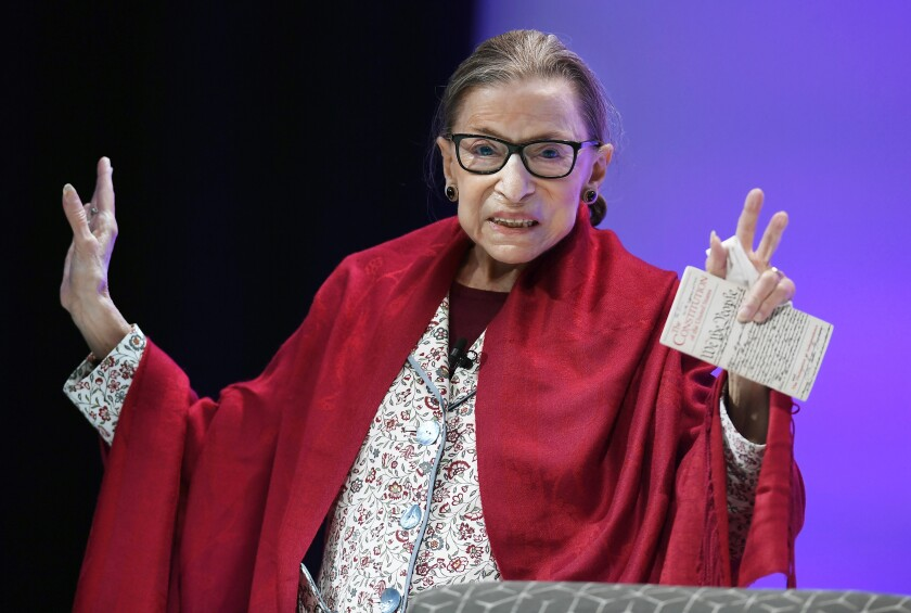 FILE - In this Oct. 3, 2019 file photo, U.S. Supreme Court Justice Ruth Bader Ginsburg gestures to students before she speaks at Amherst College in Amherst, Mass. Ginsburg usually is on the receiving end of awards, but she'll be handing out one in her name next week to a prominent philanthropist. Agnes Gund, who has given millions of dollars to support criminal justice reform and reduce mass incarceration in the United States, is the first recipient of the Justice Ruth Bader Ginsburg Woman of Leadership Award. (AP Photo/Jessica Hill)