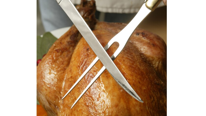 Turkey and poised carving knife