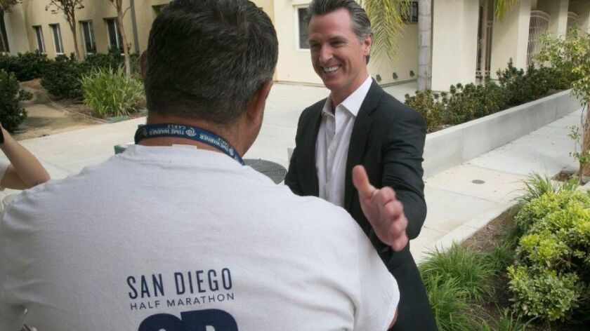 California Lt. Governor Gavin Newson, the Democratic candidate for Governor, spoke with Michael Murray, a client at the Veterans Village of San Diego during a campaign stop on Friday, October 12, 2018.