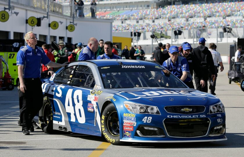 Jimmie Johnson's crew moves his car through the garage area during a practice session for the NASCAR Daytona 500 auto race at Daytona International Speedway, Saturday, Feb. 13, 2016, in Daytona Beach, Fla. (AP Photo/Terry Renna)