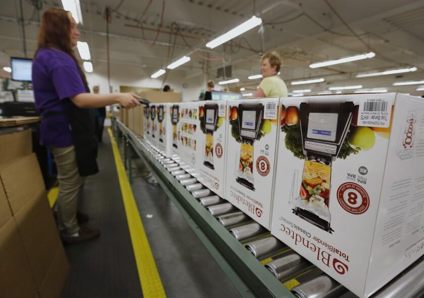 Workers process blenders for shipment at the K-Tec Inc. Blendtec factory in Orem, Utah.
