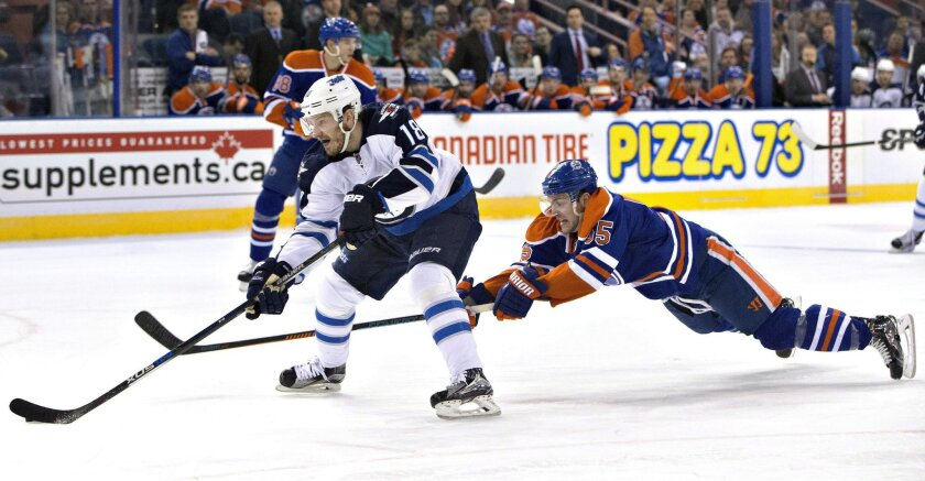Winnipeg Jets' Bryan Little (18) gets past Edmonton Oilers' Mark Letestu (55) during the first period of an NHL hockey game Saturday, Feb. 13, 2016, in Edmonton, Alberta. (Jason Franson/The Canadian Press via AP)