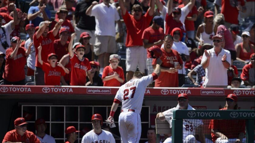 Angels outfielder Mike Trout acknowledges the fans after hitting a grand slam during a game against the Texas Rangers on July 26.