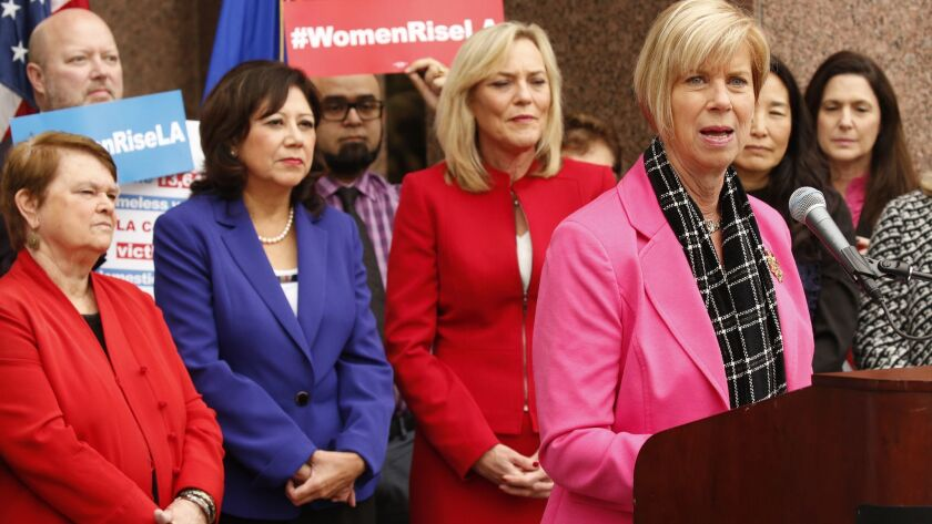 Four of the five seats on the Los Angeles County Board of Supervisors are held by women: Sheila Kuehl, from left, Hilda Solis, Kathryn Barger and Janice Hahn, at microphone, shown in 2016.
