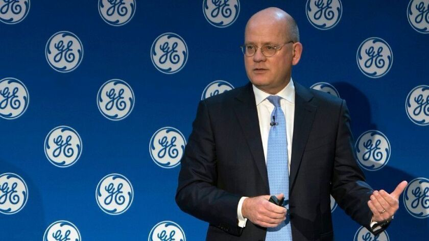 John Flannery, then CEO and Chairman of General Electric, addresses investors Nov. 13, 2017, at a meeting in New York. Flannery has been replaced at the company, effective immediately.