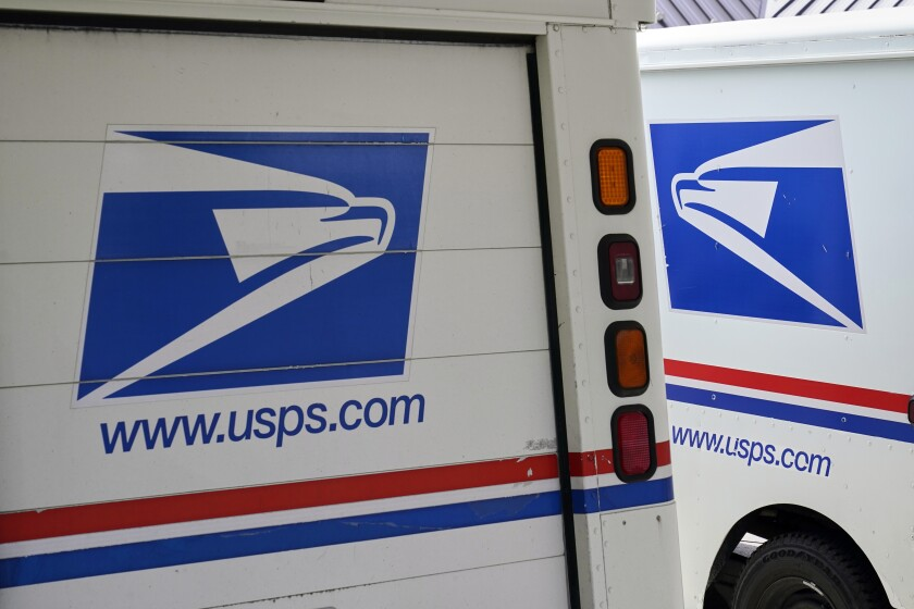 Trucks used by U.S. Postal Service carriers.
