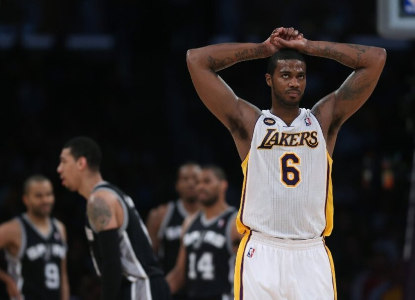 Former Lakers forward Earl Clark signed on with the Memphis Grizzlies but will be in a battle for a roster spot.