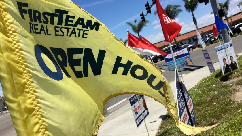 Open house signs are seen in Huntington Beach on May 21, 2016.